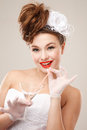 Pin up bride drinks martini professional make hair and style Royalty Free Stock Images