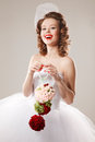 Pin up bride with unusual bouquet professional make hair and style Stock Image