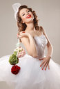 Pin up bride with unusual bouquet professional make hair and style Stock Photography