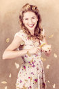Pin up cooking girl peeling potato quick recipe creative vintage portrait of a female pinup cook potatoes at fast pace in Royalty Free Stock Photography