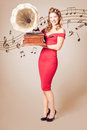 Pin-up at the disco. Vintage woman with gramophone Royalty Free Stock Photo
