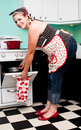 Pin-up girl in 1950s kitchen Royalty Free Stock Photo