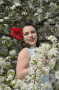 Pin up girl with a dogwood tree in the spring Royalty Free Stock Photo
