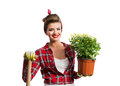 Pin-up girl holding flower pot with yelow daisies and spade Royalty Free Stock Photo
