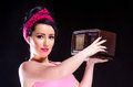 Pin up girl holding vintage radio style young woman a against a black background Royalty Free Stock Photo