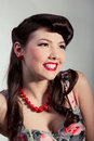 Pin-up girl with red beads Stock Photography