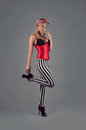 Pin up girl in red costume and striped pants Stock Photo