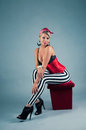 Pin up girl in red costume and striped pants Stock Images