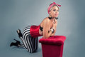 Pin up girl in red costume and striped pants Stock Image