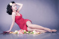 Pin up girl in red dress on picnic Royalty Free Stock Photo
