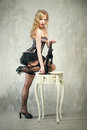 Pin up girl sexy blond posing over grey obsolete background Stock Photos
