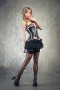 Pin up girl sexy blond posing over grey obsolete background Royalty Free Stock Image