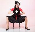 Pin up girl style retro woman analogue record sexy phonography american Stock Photos