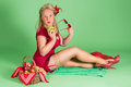 Pin up girl with suspenders picnic basket and stockings and Royalty Free Stock Photo