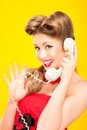 Pin up girl talking on retro telephone yellow background Royalty Free Stock Photo