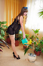 Pin-up girl watering flowers Royalty Free Stock Images