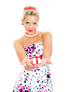 Pin-up portrait of woman with a gift. Royalty Free Stock Image