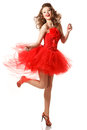 Pin up in red girl dress is jumping professional make hair and style Royalty Free Stock Photography