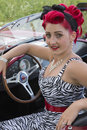 Pin up seating on the car picture of beautiful girl in a convertible Royalty Free Stock Photos