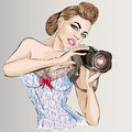 Pin-up sexy woman with camera taking pictures Royalty Free Stock Photo