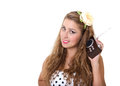 Pin-up style girl listening old radio Royalty Free Stock Images