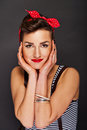 Pin-up woman with big smile on black background Stock Photos