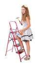 Pin up woman on ladder with hammer and saw Royalty Free Stock Photo