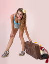 Pin up woman pulling her luggage Royalty Free Stock Photo