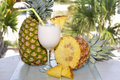 Pina Colada on Table with Pineapple Wedges Stock Photography
