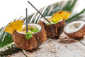 Pinacolada in the coconut with pineapple on old wooden table Stock Photo