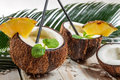 Pinacolada drink with mint served in a fresh coconut Royalty Free Stock Photo