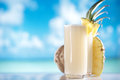 Pinacolada pina colada cocktail on beach with ocean coconut pineapple Royalty Free Stock Photos