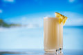 Pinacolada pina colada cocktail on beach ocean sky sea Royalty Free Stock Image