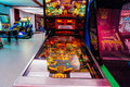 Pinball arcade game in gaming room Royalty Free Stock Photo