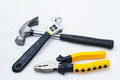 Pincer pliers claw hammer and wrench on white background Stock Images