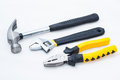 Pincer pliers claw hammer and wrench on white background Royalty Free Stock Image