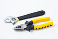Pincer pliers and wrench on white background Royalty Free Stock Images