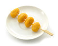 Pinched gold egg yolks on white background Stock Photos