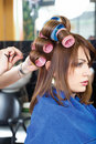 Pinching client's curlers Royalty Free Stock Photo