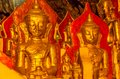 Pindaya caves gold plated statues of buddha in are buddhist shrines where thousands of buddha images have been consecrated for Stock Photography