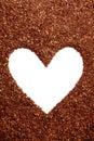 Pine bark mulch surrounding white heart symbol Royalty Free Stock Photo