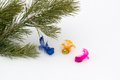 Pine branch with decorative multi coloured birds against white snow it can be used as a christmas card Stock Photo