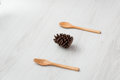 Pine cone with fork and spoon on grey Royalty Free Stock Photo