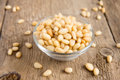 Pine nuts tasty fresh in glass bowl on wooden background table close up horizontal Royalty Free Stock Image