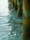 Pine poles of jetty in maldives sea Royalty Free Stock Photography