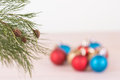 Pine tree branch with red blue and gold christmas baubles background Stock Images