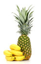 Pineapple and bananas on a white background Royalty Free Stock Photo