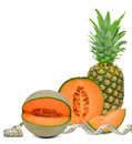 Pineapple and cantaloupe melon with measuring tape isolated on white background Royalty Free Stock Images