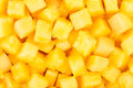 Pineapple chunks background closeup many Royalty Free Stock Images