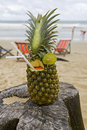 Pineapple, cocktail on the beach Stock Photo